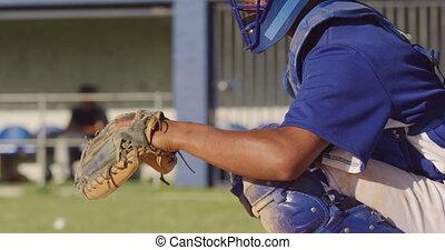 Baseball player catching a ball during a match