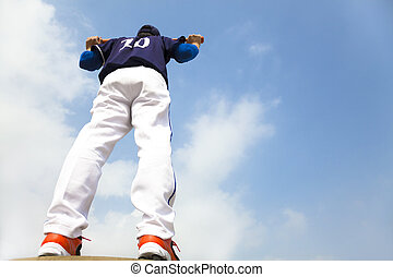 baseball player holding a bat with cloud background