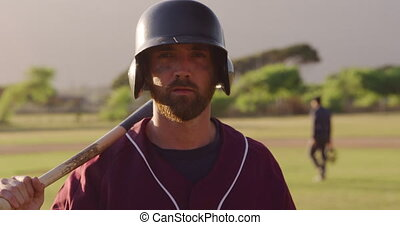 Baseball player looking at camera - Portrait of a Caucasian ...