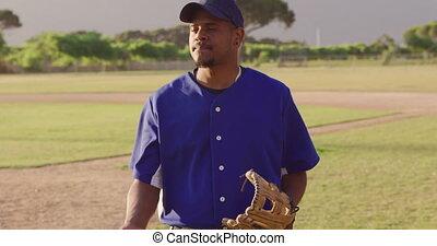 Baseball player looking at camera