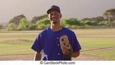 Baseball player looking at camera - Portrait of a mixed race...