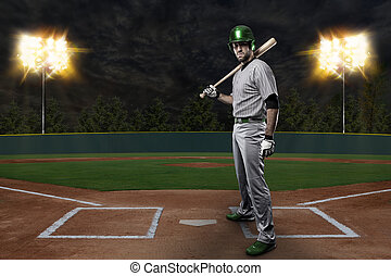 Baseball Player on a Green Uniform on baseball Stadium.