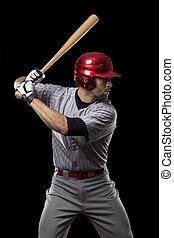 Baseball Player on a black background. Studio Shot.