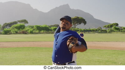 Baseball player throwing a ball during a match - Front view ...
