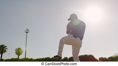 Baseball player throwing a ball during a match - Low angle ...