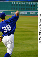 baseball player throwing the ball, with scoreboard in the ...