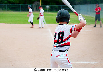 Baseball player waiting for pitch.