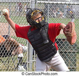 Baseball Player - youth baseball player in action of trowing...