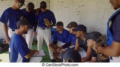 Baseball players preparing the match - Side view of a ...