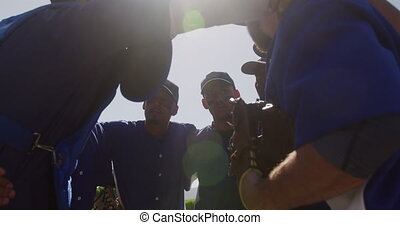 Baseball players preparing the match - Side view of multi-...
