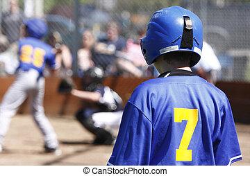 Baseball players up to bat.