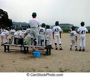 Baseball team - A children baseball team watching to the...