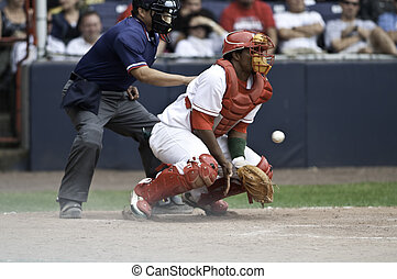 Baseball Umpire and Catcher - The catcher standing up ...