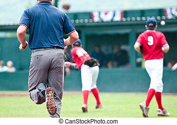 Baseball umpire running during game