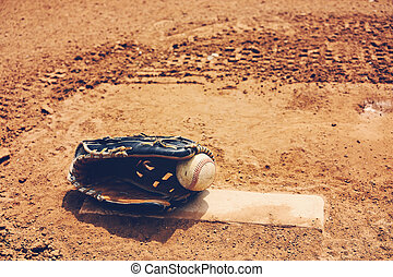 Baseball with glove on pitcher's mound