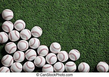 Baseballs on green turf viewed from above - Several...