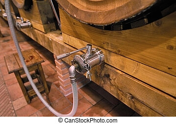 Basement cellar with large wooden barrels