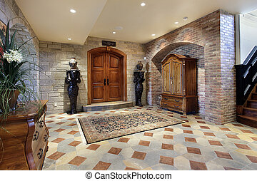 Basement foyer area with doors to theater room