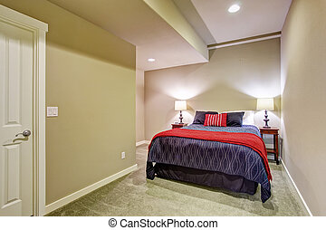 Basement guest bedroom with blue and red bed
