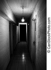 Light shining in dark basement corridor. Motion blur.