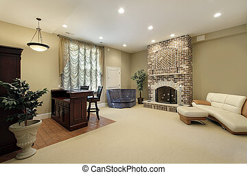 Basement with brick fireplace