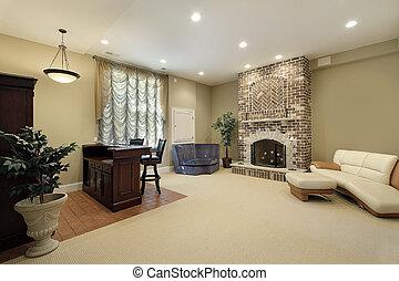 Basement with brick fireplace
