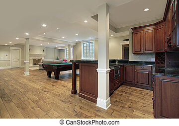 Basement with fireplace and bar - Basement in new ...