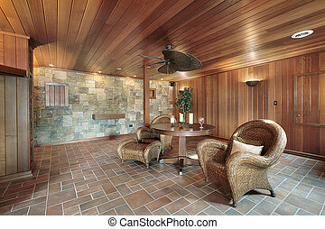 Basement with stone and wood walls