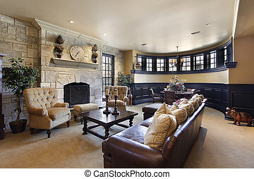 Basement with stone fireplace