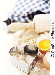 Basic baking ingredients over white