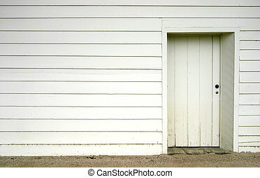 Basic Doorway - A simple white doorway on the side of an old...