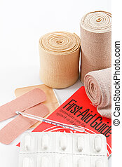 Basic First Aid Elements - Bandages, pain killer tablets and...