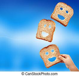 Basic food abundance - bread slices flying against blurry blue background