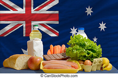 basic food groceries in front of australia national flag