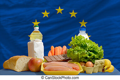 basic food groceries in front of europe national flag - ...