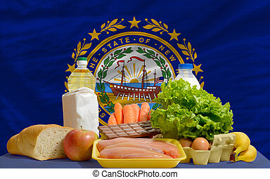 basic food groceries in front of new hampshire us state flag