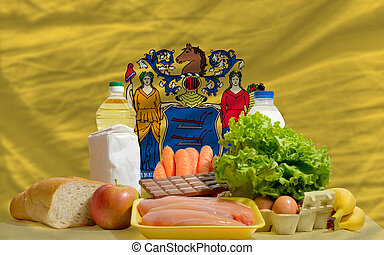 basic food groceries in front of new jersey us state flag