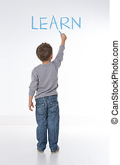 "basic principle of life - child writes the word ""learn"" on a..."