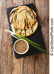 Basic recipe Pajeon Korean pancakes with green onions close-...