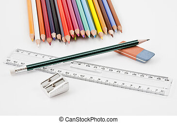 Basic school supplies with colored pencils, pencil, eraser,...