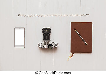 Basic set of hipster blogger girl on wooden white table