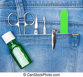 Basic set of manicure tools in jeans pocket