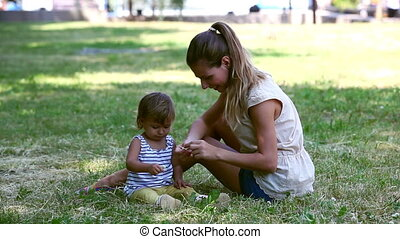 Basics of botany - Mom and her baby girl collecting flowers...