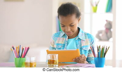 Basics - Smiling girl learning the basics of computer...