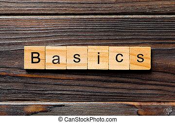 BASICS word written on wood block. BASICS text on table, concept