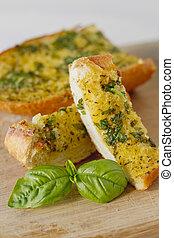 Basil Garlic Bread - Basil garlic bread on a cutting board.