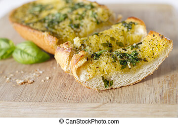 Basil Garlic Bread - Basil garlic bread on a cutting board.