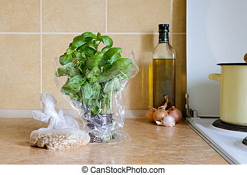 Basil in a pot, with Pinoli