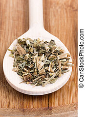 Basil tea on a wooden kitchen spoon