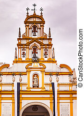 Basilica de la Macarena Bell Tower with Bronze Bells and Weather Vanes Seville, Andalusia Spain. Built in the 1700s. Houses the statue of the Macarena, the Virgin Mary with tears.